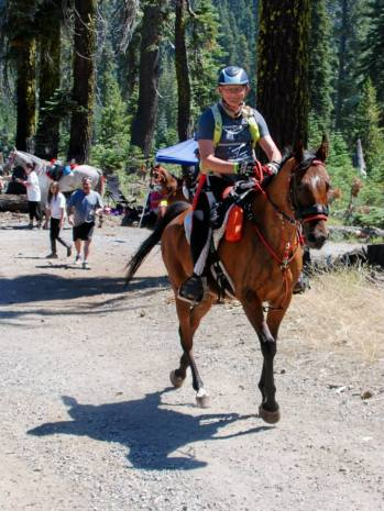 Ron Sproat on FS SAR Tiki Warrior, leaving Robinson Flat at the 2014 Tevis Cup.